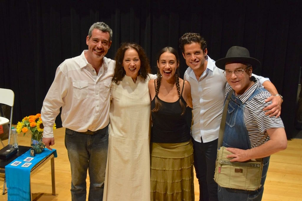 """Playwright Oliver Mayer (far left) and Perla Batalla (in white dress) with cast members from of """"Blue House."""""""