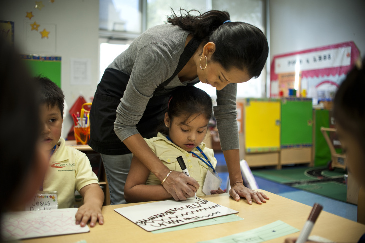 Training in self control starts early at Camino Nuevo. Karina Rodriguez leads preschoolers through a motor skills exercise, asking them to start and stop based on musical cues. Students will be exposed to 14 years of curriculum designed to address academic and soft skills.