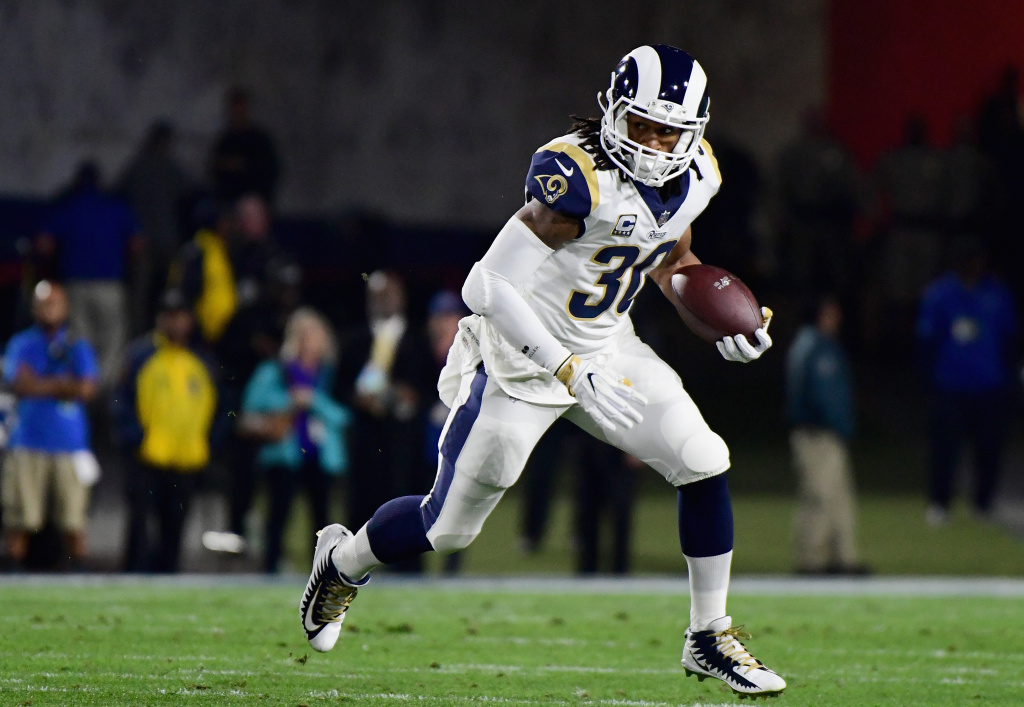 Running back Todd Gurley #30 of the Los Angeles Rams runs with the ball after taking a hand off during the first quarter of the NFC Wild Card Playoff game against the Atlanta Falcons at Los Angeles Coliseum on January 6, 2018 in Los Angeles, California.