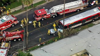 Firefighters at the scene of a head-on accident between a BMW and an LA County bus in Hollywood Tuesday morning.