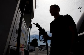 Jason Caya of San Francisco gets ready to fill his car with gas at a Shell gas station on April 27, 2011, in San Francisco.
