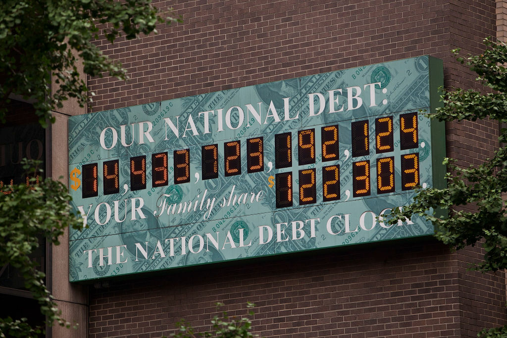 The National Debt Clock, a billboard-size digital display showing the increasing US debt, is seen on the corner of Sixth Avenue and West 44th Street on August 1, 2011 in New York City. It's higher now.