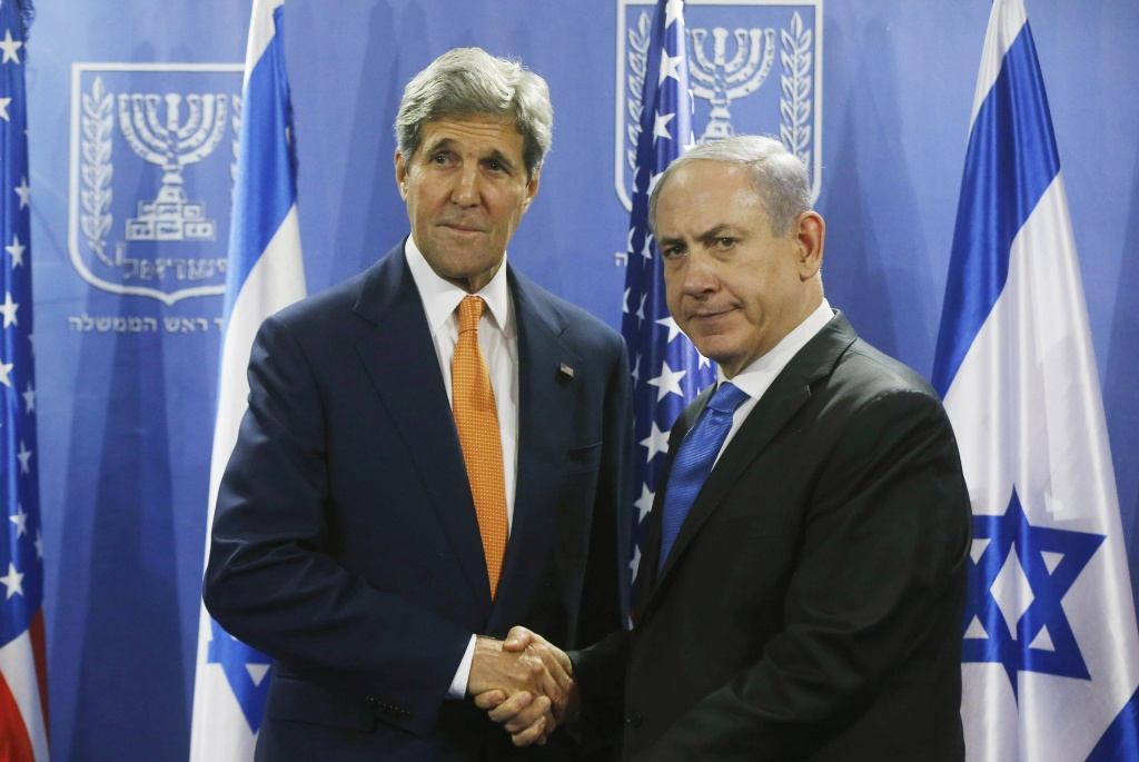 U.S. Secretary of State John Kerry (L) shakes hands with Israeli Prime Minister Benjamin Netanyahu in Tel Aviv on July 23, 2014. Kerry is meeting with United Nations Secretary-General Ban Ki-moon, Netanyahu, and Palestinian president Mahmud Abbas as efforts for a cease-fire between Hamas and Israel continues.