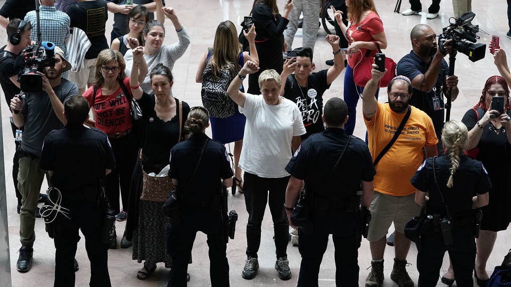 Activists chant during a protest outside the office of Senate Judiciary Committee Chairman Sen. Chuck Grassley of Iowa. Activists protested against Supreme Court nominee Judge Brett Kavanaugh.