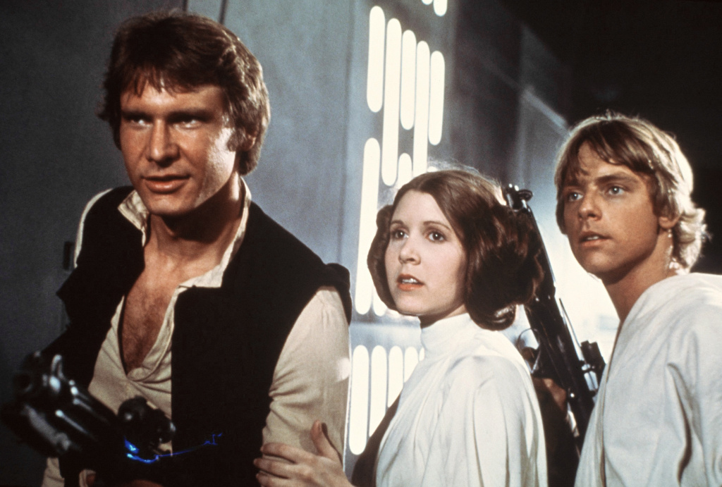 File: This file publicity image provided by 20th Century-Fox Film Corporation shows Harrison Ford, as Han Solo, Carrie Fisher, as Princess Leia Organa, and Mark Hamill, as Luke Skywalker. in a scene from the 1977