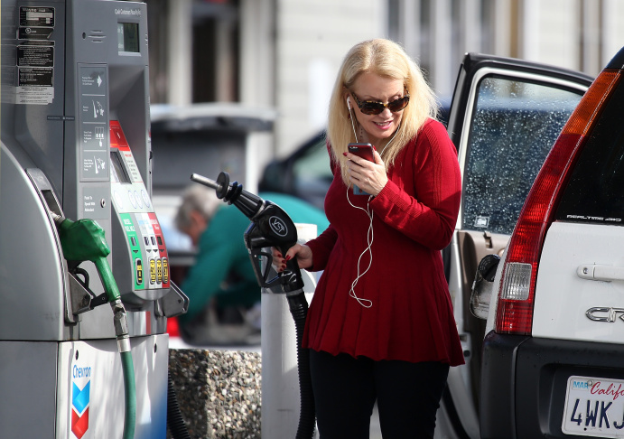 A gasoline pump rests in the tank of a car in San Anselmo, California.
