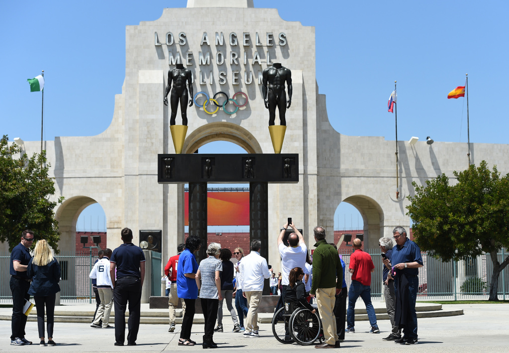 IOC Evaluation Commission Chairman Patrick Baumann (C) takes a photograph of the Los Angeles Memorial Coliseum with Los Angeles Mayor Eric Garcetti and LA2024 committee members, IOC Evaluation Commission members, Olympic and paralympics athletes in front of Los Angeles Memorial Coliseum after a venue tour May 11, 2017, in Los Angeles.