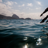 Competitors jump into the waters of Copacabana beach as they take part in the Marathon Swimming Challenge - Aquece Rio Test Event for Rio 2016 Olympics in Rio de Janeiro, Brazil.