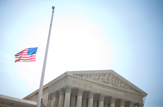 WASHINGTON - JUNE 28: A flag flies at half staff outside the U.S. Supreme Court building in honor of Sen. Robert C. Byrd (D-WV), who died this morning.