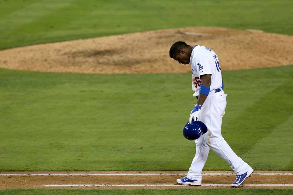 Yasiel Puig reacts after grounding into a double play in the ninth inning against the St. Louis Cardinals in Game Four of the National League Championship Series at Dodger Stadium on October 15, 2013.