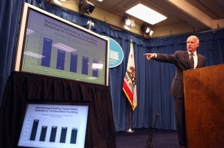 Gov. Jerry Brown points to a chart as he speaks to reporters during the announcement of his proposed budget at the California State Capitol on Jan. 10, 2011 in Sacramento.