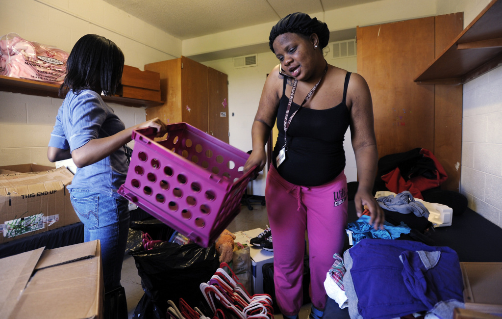 Shaw University freshmen Artricia Brittle (R), 18 of Washington, D.C., coordinates a way home as she packs up her belongings in her dorm room with along with her roommate Denaysha Bowen, 18 of Maryland, on April 17, 2011 in Raleigh, North Carolina.