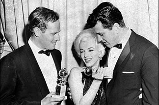 Charlton Heston, with Marilyn Monroe (center) and Rock Hudson, after Heston and Monroe won Golden Globes awards.