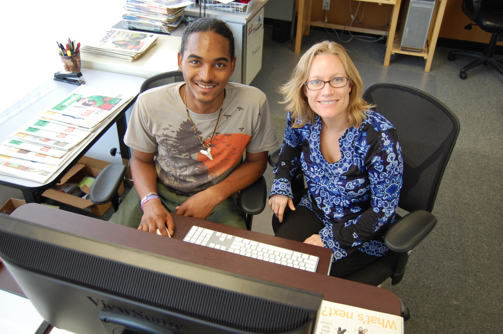 L.A. Youth co-managing editor Amanda Riddle, right, works with Charles Watkins, a teen in foster care, on his story about being grateful that he was adopted. The newspaper written by teens for teens will cease publishing next week.