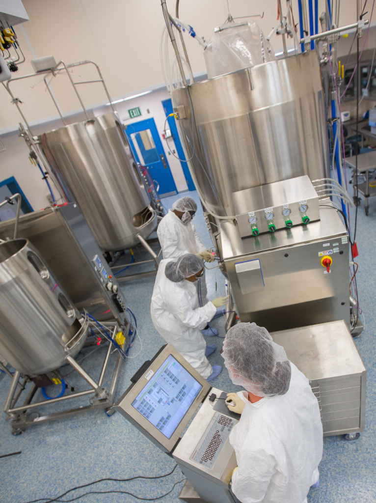 Cell culture operators prepare a 2000-liter single-use bioreactor to produce proteins used to make vaccines.