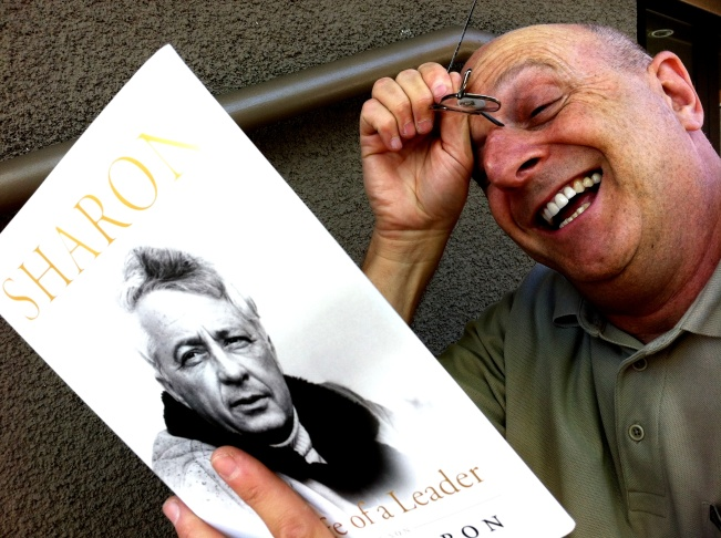 Off-Ramp commentator Hank Rosenfeld with the book he co-wrote with Irv Brecher, the original Old Jew Telling Jokes. (Photo: John Rabe)