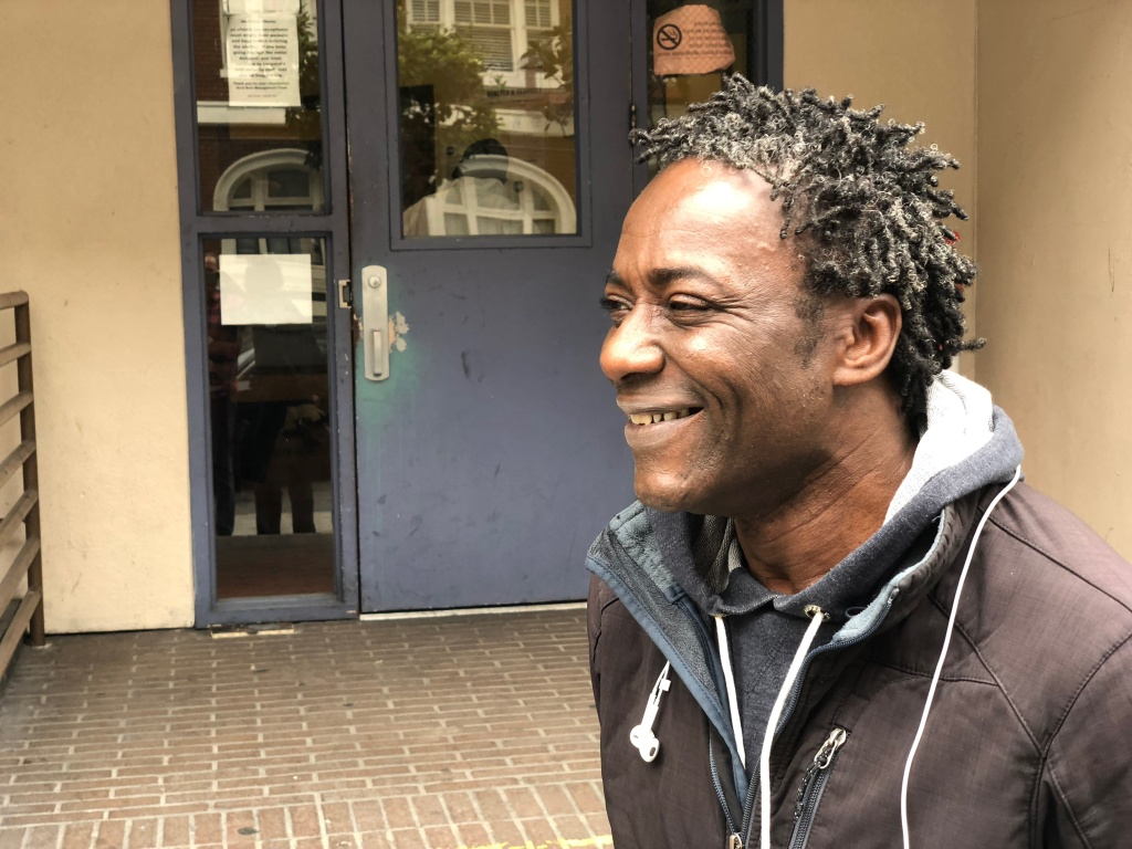 Sean Kayode, outside the Next Door homeless shelter in San Francisco on July 26, 2018. Kayode is suing the city, saying he lost his means of food-delivery employment and his home when his car was impounded in March—for having too many parking tickets.