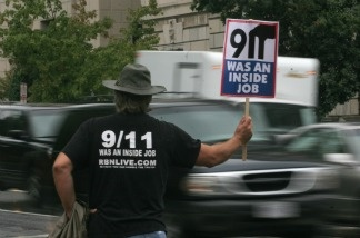 A protestor, near the White House in Washington D.C. on September 11, 2007, holds a sign claiming the September 11, 2001 attacks on the U.S. were an inside job.