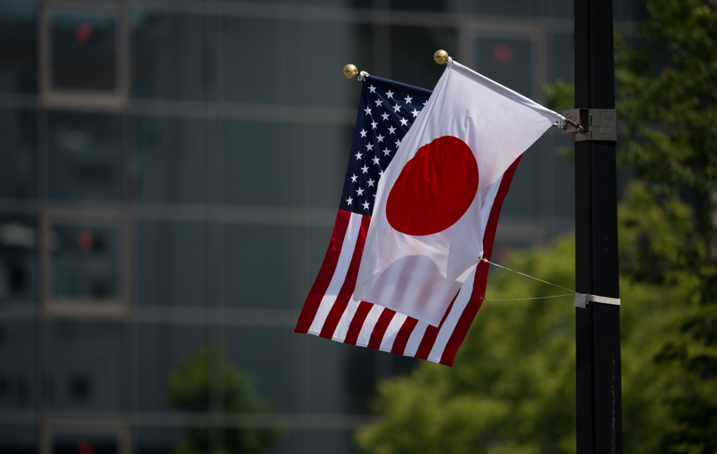 CORRECTION - A Japanese and a US flag are seen next to the Hiroshima Peace Memorial in Hiroshima on May 27, 2016. US President Barack Obama was to make history later on May 27 when he travels to Hiroshima -- becoming the first sitting US leader to visit the site that ushered in the age of nuclear conflict.