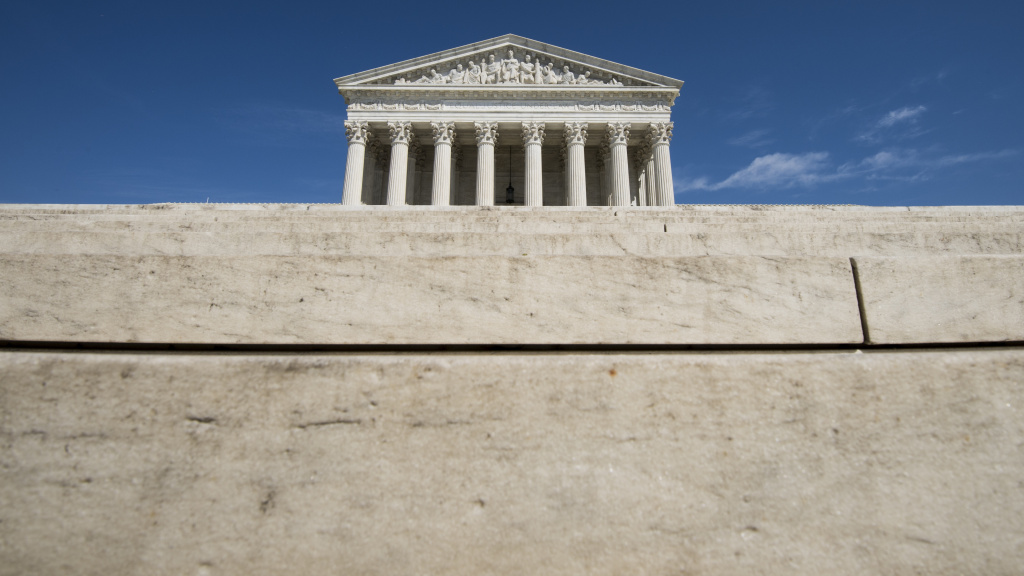 The Supreme Court has ruled previously that police cannot search the private area around a house without a warrant, but the question here was whether the warrant requirement applied to motor vehicles parked within that area.