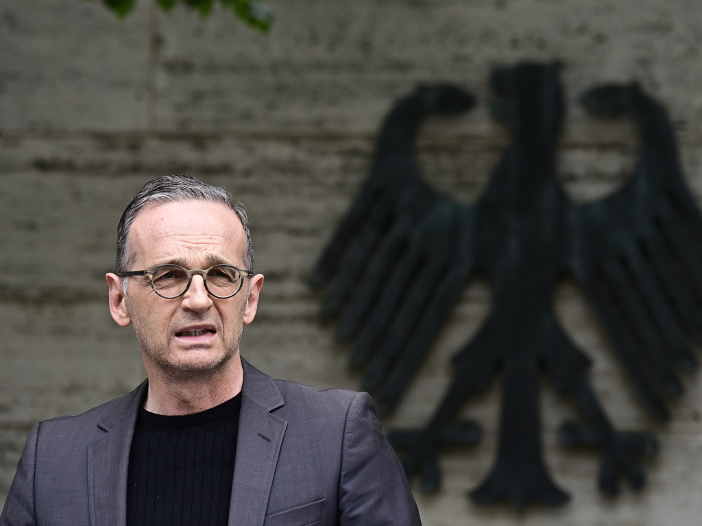German Foreign Minister Heiko Maas addresses the media in Berlin on Friday. Germany has reached an agreement with Namibia that will see it officially recognize as genocide the colonial-era killings of tens of thousands of people and commit to spending a total of 1.1 billion euros ($1.3 billion), largely on development projects.