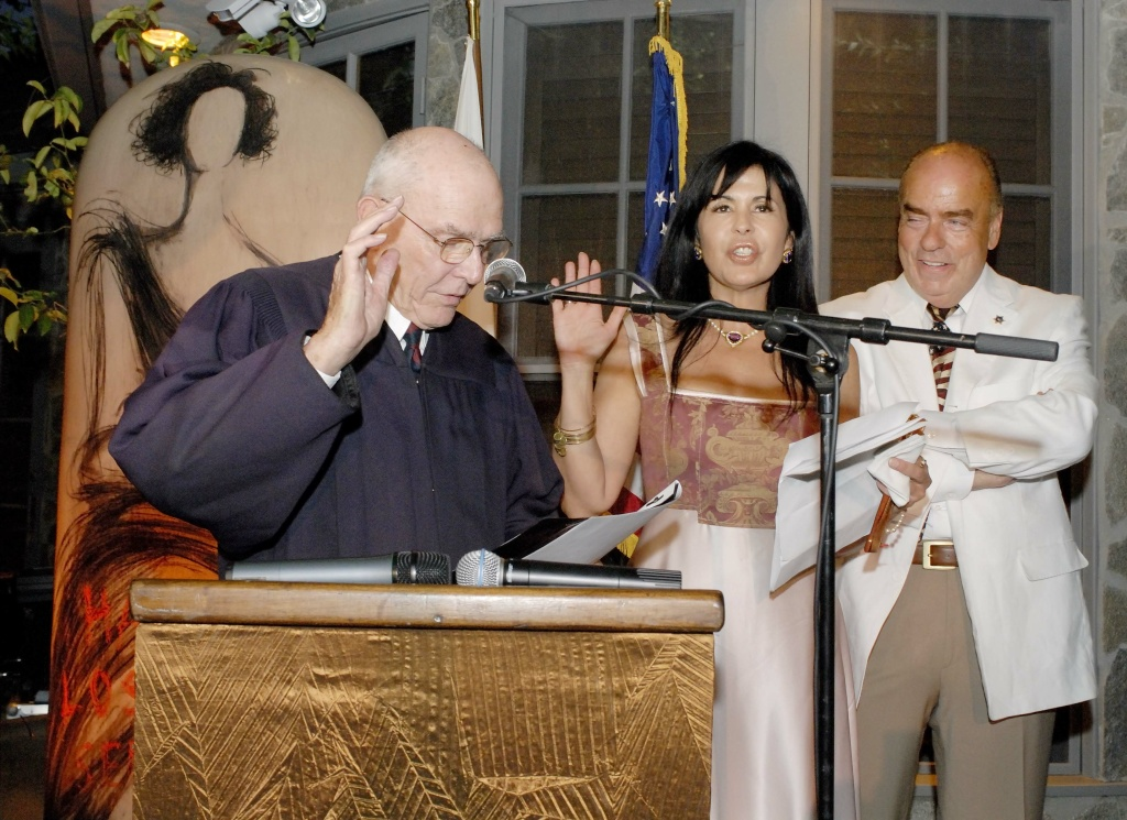 File: Judge Harry Pregerson of the U.S. 9th Circuit Court of Appeals swears in Latina actress, singer and former Miss Venezuela, Maria Conchita Alonso, center as a U.S. citizen in special ceremonies at the Beverly Hills home of Philanthropist, Arthur Kasse, right, Saturday, Aug. 18, 2007.
