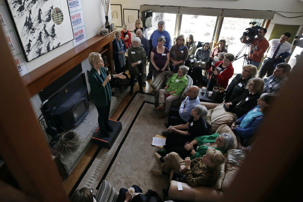 Democratic presidential candidate Sen. Elizabeth Warren, D-Mass., left, speaks at a campaign house party, last month in Salem, NH. Warren has proposed abolishing the Electoral College.