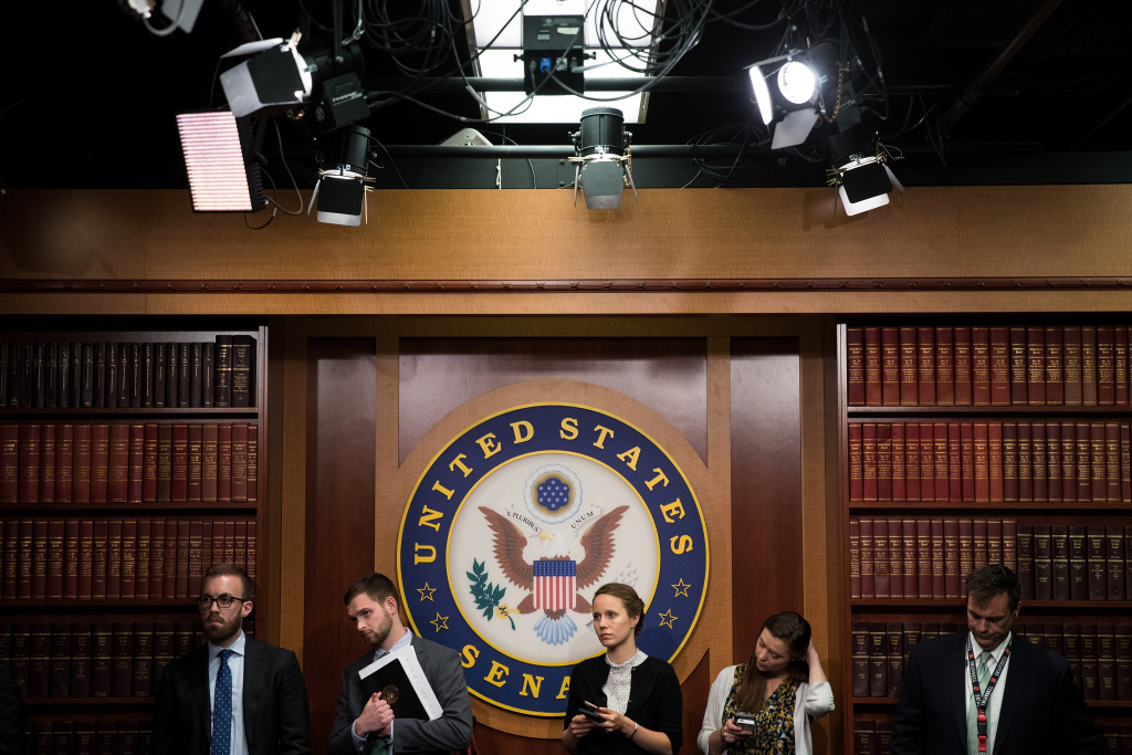 Senate staff members look on during a press conference about the Senate Republican health care bill, on Capitol Hill, June 26, 2017 in Washington, DC.