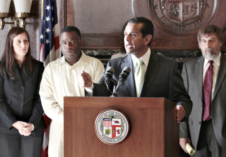 Los Angeles Mayor Antonio Villaraigosa at podium, announces the city and The Los Angeles Unified School District board will move ahead with reform efforts with or without the support from the Teachers' Union on Thursday, Oct. 7, 2010, during a news conference at the City Hall in Los Angeles. From left: teachers at Gompers school: Sarah Talley and Kenneth Aubrey. Mark Rosenbaum, Chief Council ACLU, far right.