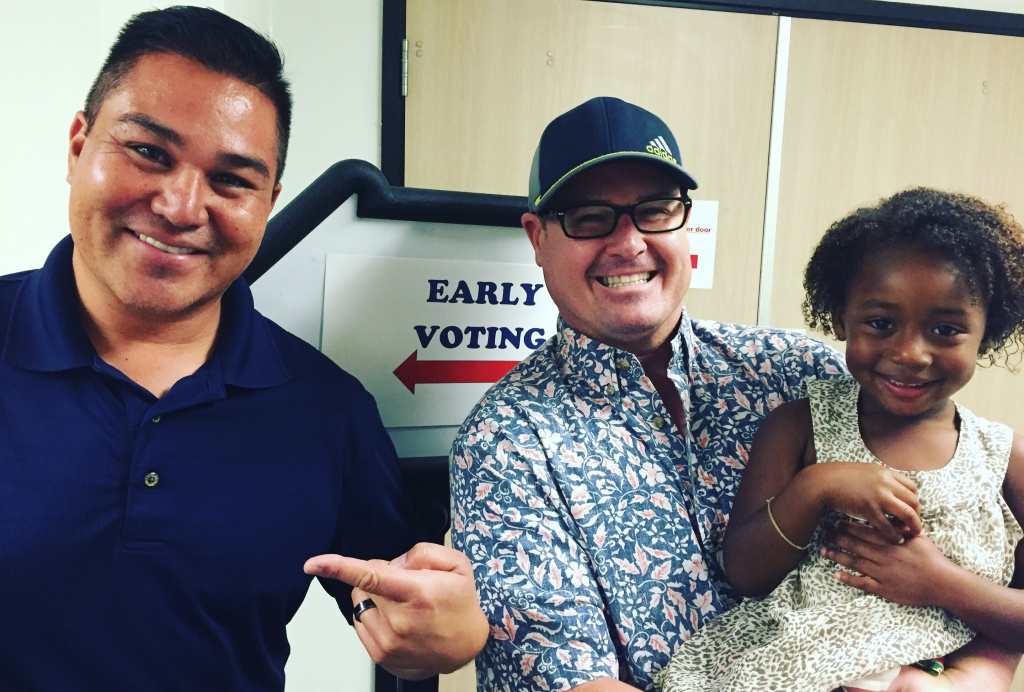 Aaron, Matthew, and Lilly Borja of Long Beach, after early voting in Norwalk on Tuesday, Oct. 11, 2016.