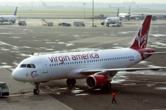 A Virgin America plane waits at JFK International Airport in New York. Olajide Oluwaseun Noibi is charged with stowing away on a Virgin America flight from JFK to LAX on June 25, 2011.