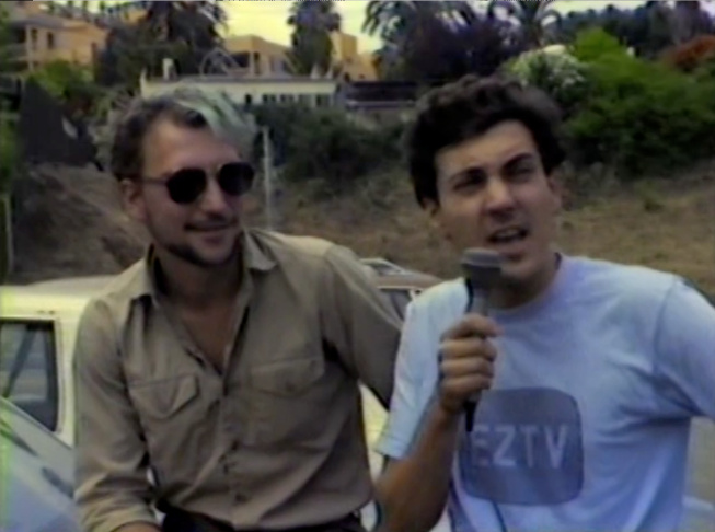 Michael J. Masucci interviewing a bystander at the Gay Pride Parade on Santa Monica Boulevard, c. 1983. 60 minutes. EZTV Video Collection ONE Archives at the USC Libraries