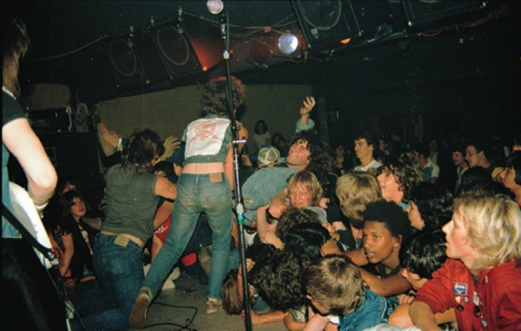 Stage-diver Toby 'Rage' Staniford gets airborne at a Death Angel show at Ruthie's Inn, Berkeley 1985