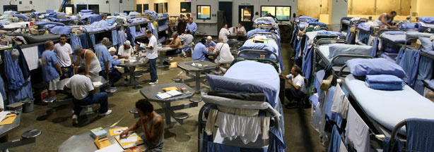 Inmates at the Mule Creek State Prison interact in a gymnasium that was modified to house prisoners August 28, 2007 in Ione, California.