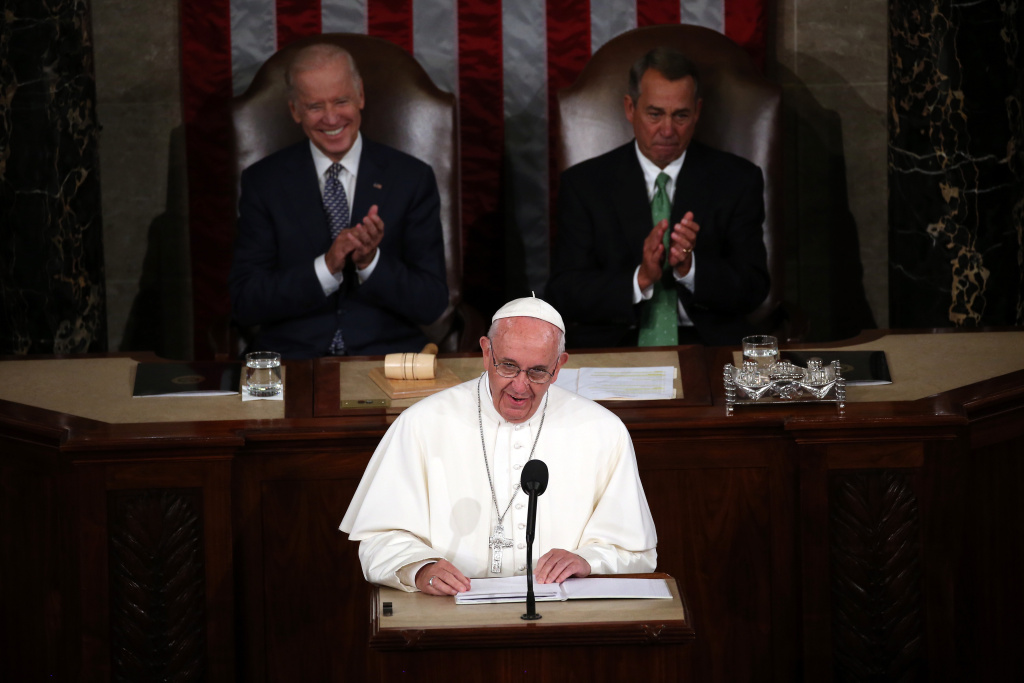 Pope Francis (C) addresses a joint meeting of the U.S. Congress with with Vice President Joe Biden (L) and Speaker of the House John Boehner (R-OH) in the House Chamber of the U.S. Capitol on September 24, 2015 in Washington, DC.  Pope Francis is the first pope to address a joint meeting of Congress and will finish his tour of Washington later today before traveling to New York City.