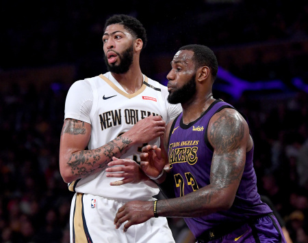 LeBron James #23 of the Los Angeles Lakers guards Anthony Davis #23 of the New Orleans Pelicans during a 112-104 Laker win at Staples Center on December 21, 2018 in Los Angeles, California.
