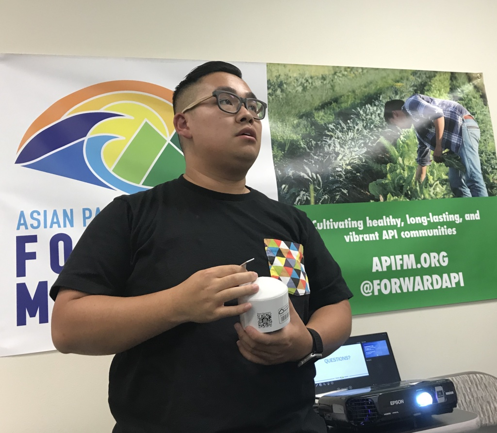 Kevin Liao, who works for Asian Pacific Islander Forward Movement, holds up one of the air quality sensors he's hoping to distribute throughout Alhambra and Monterey Park.