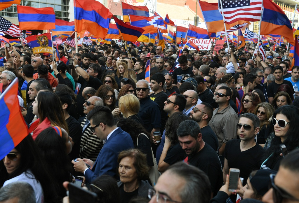 Thousands of members of the Armenian community crowd outside the Turkish Consulate on April 24, 2017 in Los Angeles, California, marking the 102nd anniversary of the Armenian genocide when as many as 1.5 million Armenians died in a campaign blamed on the Ottoman Turkish government, in Los Angeles, California on April 24, 2017. More than 200,000 people of Armenian descent live in Los Angeles County, making it the home to the largest Armenian community outside of Armenia. / AFP PHOTO / Mark RALSTON        (Photo credit should read MARK RALSTON/AFP/Getty Images)