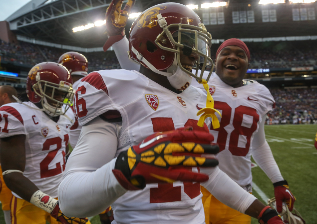 Anthony Brown #16 of the USC Trojans is congratulated by teammates after scoring a touchdown on a blocked punt against the Washington Huskies on Oct. 13, 2012 at CenturyLink Field in Seattle, Washington.