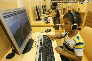Children play educational video games.