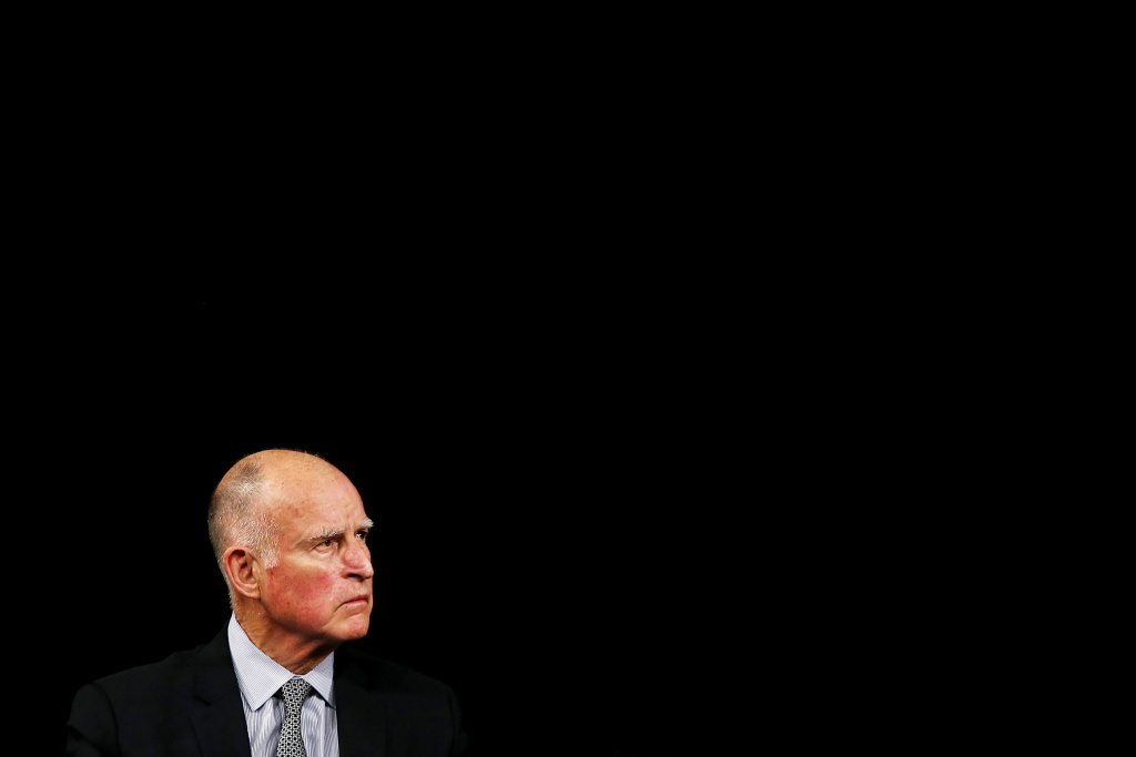 California governor Jerry Brown looks on as Israeli prime minister Benjamin Netanyahu speaks at the Computer History Museum on March 5, 2014 in Mountain View, California.