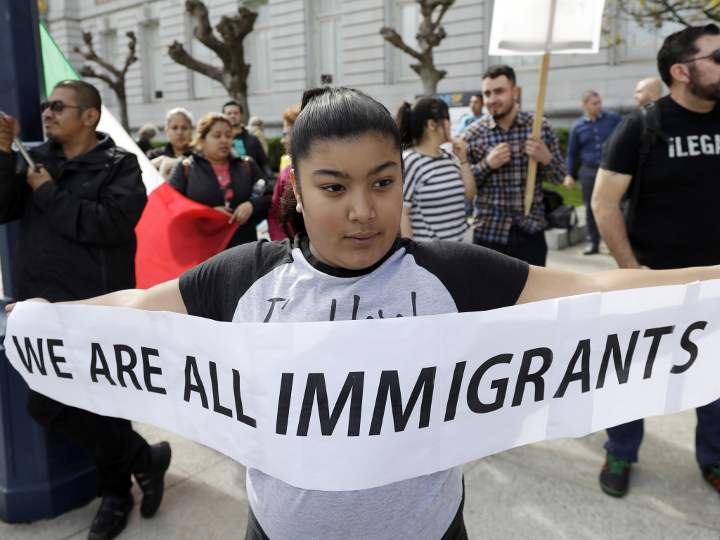 Delilah Gutierrez holds a sign during a protest against President Donald Trump's efforts to crack down on immigration in San Francisco.