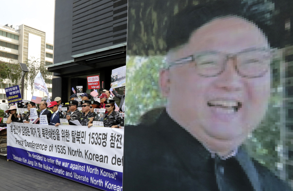 South Korean conservative activists and North Korean defectors attend a rally against North Korea and North's leader Kim Jong Un in downtown Seoul, South Korea, Friday, Sept. 8, 2017. South Korea is closely watching North Korea over the possibility it may launch another intercontinental ballistic missile as soon as Saturday when it celebrates its founding anniversary. (AP Photo/Lee Jin-man)