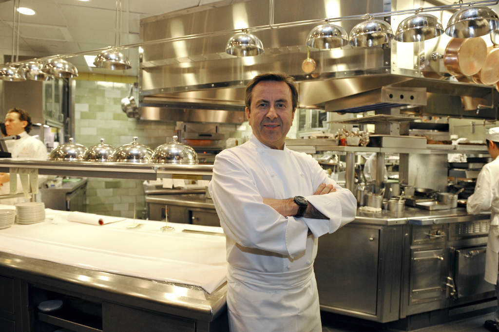 """French chef Daniel Boulud poses in the kitchen at his flagship restaurant """"Daniel"""" in New York, October 27, 2009."""