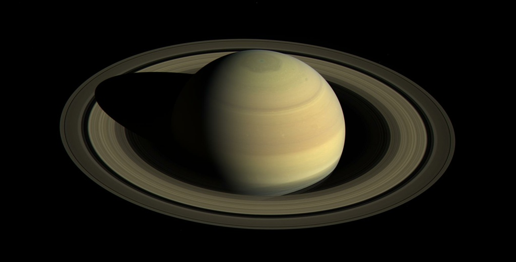 Since NASA's Cassini spacecraft arrived at Saturn in mid-2004, the planet's appearance has changed greatly. The shifting angle of sunlight as the seasons march forward has illuminated the giant hexagon-shaped jet stream around the north polar region, and the subtle bluish hues seen earlier in the mission have continued to fade. This view shows Saturn's northern hemisphere, as that part of the planet nears its northern hemisphere summer solstice. Saturn's year is nearly 30 Earth years long. Cassini scanned across the planet and its rings on April 25, 2016, capturing three sets of red, green and blue images to cover this entire scene. The images were obtained using Cassini's wide-angle camera at a distance of approximately 1.9 million miles from Saturn.