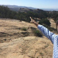 NBC4's Joel Grover points to the Santa Susana Field Lab from the Sage Ranch Park in the Simi Valley.