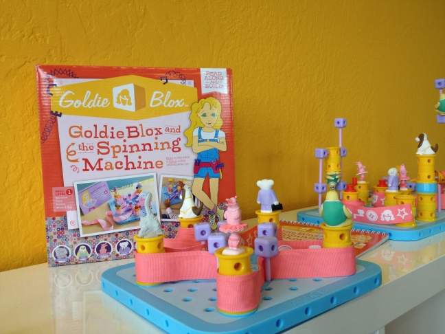 Debbie Sterling poses with Goldiblox a game she invented that encourages girls to get interested in engineering.