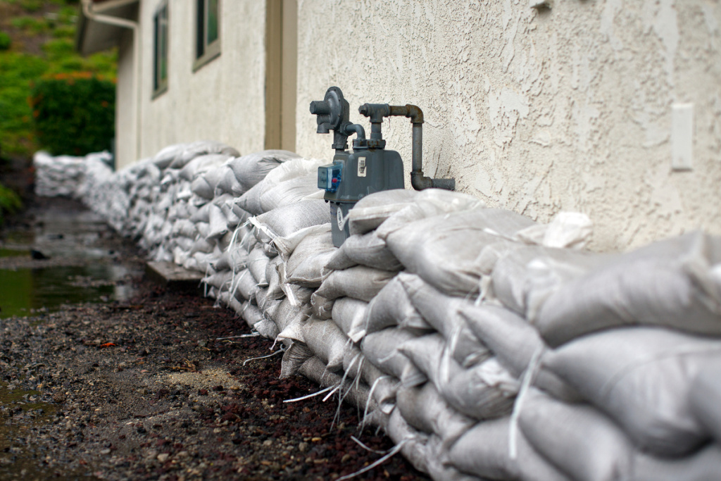 Sandbags line a home at the base of a hill in Camarillo Springs, Ventura County, in Dec. 2014.