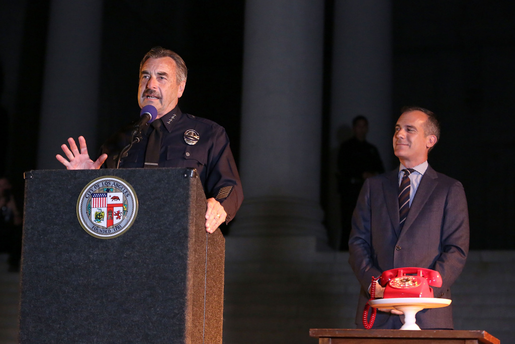 Los Angeles Police Department Chief, Charlie Beck and Los Angeles Mayor, Eric Garcetti attend The City of Los Angeles and DC Entertainment Bat-Signal Lighting Ceremony honoring Adam West at Los Angeles City Hall on June 15, 2017