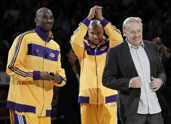 In this June 18, 1981 file photo, Jerry Buss holds a Los Angeles Lakers shirt in Los Angeles. Buss died Monday, Feb. 18, 2013. Buss, the Lakers' playboy owner who shepherded the NBA franchise to 10 championships, has died. He was 79. Bob Steiner, an assistant to Buss, confirmed Monday, Feb. 18, 2013  that Buss had died in Los Angeles. Further details were not available.